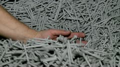 Output of molding plastic products. Hands with lot of dowel. Stock Footage