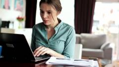 Young businesswoman working on laptop at home HD Stock Footage