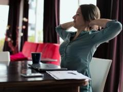 Businesswoman finishing work on laptop and relaxing in home NTSC Stock Footage