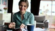 Happy businesswoman with tablet computer at home HD Stock Footage