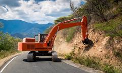 excavator repair the road. - stock photo