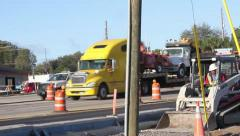 skid loader works street construction zone downtown - stock footage