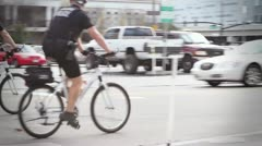 Police officers on bicycles patrol the streets - stock footage