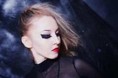 Young woman with bright gothic makeup closeup Stock Photos