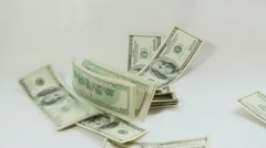 American dollars falling on white background Stock Footage