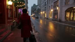 Scenes from Quebec City - girl walks towards Chateau Frontenac in slow motion Stock Footage