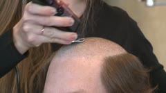 HAIRCUT BUZZ ON MAN WITH FULL HEAD OF HAIR HD 1920X1080 1080 VIDEO STOCK FOOTAGE - stock footage