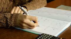 Girl studying chemistry, writing down - stock footage
