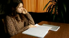 Beautiful young girl studying at home Stock Footage
