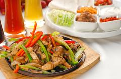 Original fajita sizzling hot  on iron plate Stock Photos