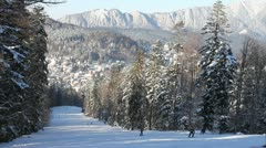 Beautiful slope and ski resorts in mountains - stock footage