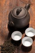 chinese green tea pot and cups - stock photo