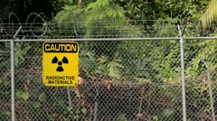 caution radiation sign materials perimeter fence - stock footage