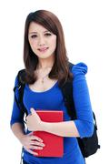 Cute student holding her books - stock photo