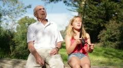 Granddaughter Catches Fish with Help from Grandfather Stock Footage
