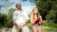 Stock Video Footage of Granddaughter Catches Fish with Help from Grandfather