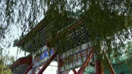 Stock Video Footage of swing willow & orient ancient Memorial arch in beijing china.