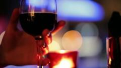 Female hand taking a glass of red wine Stock Footage