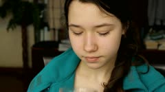 Portrait of a girl drinking tea during breakfast in the morning Stock Footage