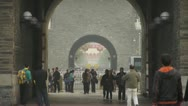 Stock Video Footage of tourist pass ancient city gate tower & arch in beijing china.