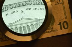 dollar and magnifier - stock photo