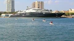 mega yacht super yacht luxury ship Serene and jet ski - stock footage