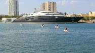 Mega yacht super yacht luxury ship Serene and jet ski Stock Footage