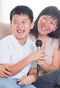 asian family singing karaoke - stock photo