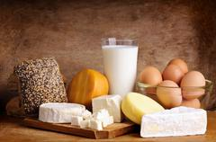 Cheese, bread, milk and eggs Stock Photos