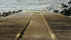 Stairway to the sea with rocks Stock Footage