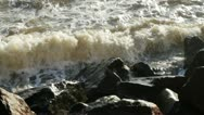Stock Video Footage of waves splashing against rocks with sun