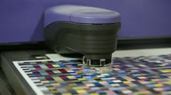 Spectrophotometer robot measurement of color patches in prepress Stock Footage