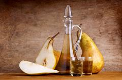 composition with pear brandy - stock photo