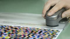 Spectrophotometer measurement of color patches in prepress on tes Stock Footage