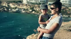 Mother with her son on cliff at the view point, slow motion shot at 240fps Stock Footage