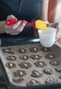 Glazing cookies on baking paper in a tray Stock Photos