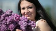 Laughing pregnant woman with bouquet Stock Footage