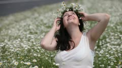 Happy pregnant woman in camomile field Stock Footage