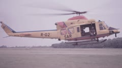 SAR rescue Helicopter touching down. Stock Footage