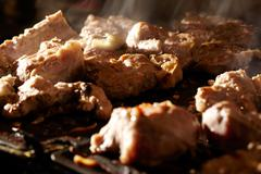 Meat on the bbq. Stock Photos