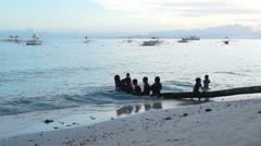 Filipino children play at sunset. Stock Footage