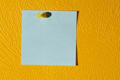 Pink sticker on the yellow wall. Stock Photos