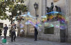 Soap bubbles performance in barcelona. Stock Photos