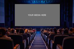 empty cinema screen with audience. - stock photo