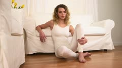 Caucasian woman sitting on floor after yoga Stock Footage