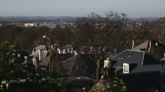 Slow pan over rooftops with bus - stock footage