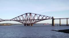 Wide static shot of train crossing Forth Rail Bridge Stock Footage