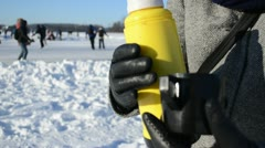 Hands open thermos pour hot tea coffee drink winter sport skate Stock Footage