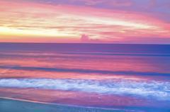 Pink ocean sunrise Stock Photos