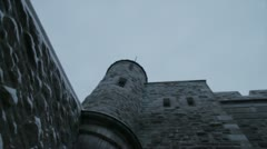 Scenes from Quebec City - walking under gate in slow motion twilight Stock Footage